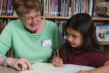Tutors in GPLC's OASIS Intergenerational Tutoring program help students in grades K-4 develop reading skills and self-esteem.