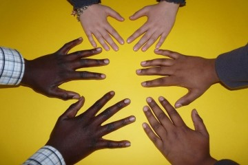 Hands of different races reaching out