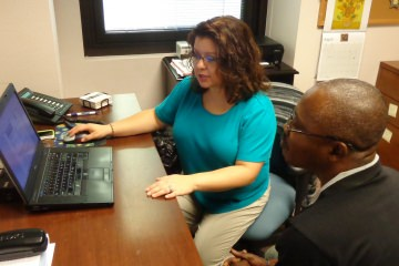 Transitions Manager Andrea Horton-Mericli meets with a student about his career goals and what skills and training are needed to reach them.